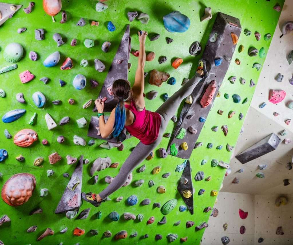 girl indoor rock climbing