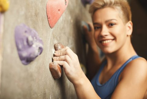 girl climbing at a climbing gym