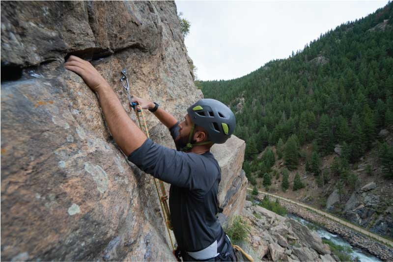 clipping a climbing bolt